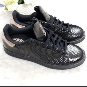 hot sale online eb526 4e8c0 Women s Black Gold Adidas Shoes on Poshmark